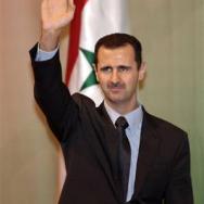 bachar_el_assad_bras_drapeau