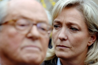 """(FILES) - A photo taken on March 17, 2007 shows Marine Le Pen (R) listening to her father, France's far-right Front national party's (FN) president and presidential candidate Jean-Marie Le Pen, as he delivers a speech in his house in La Trinite-Sur-Mer, western France. France's far-right was plunged into disarray on April 8 as National Front leader Marine Le Pen openly split with her father and party founder after gas chamber comments she described as """"political suicide"""".  AFP PHOTO / MARTIN BUREAU"""