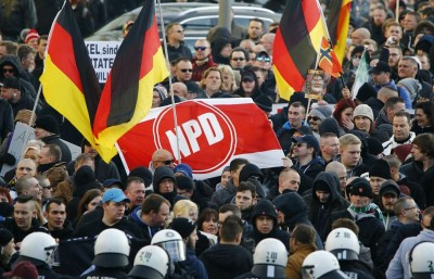 855703-supporters-of-anti-immigration-right-wing-movement-pegida-protest-in-cologne