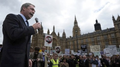 United Kingdom Independence Party (UKIP) leader Nigel Farage addresses protesters on May 14, 2011 during a Rally against Debt demonstration in favor of government cuts in central London. Britain's deficit for the 2010-2011 financial year fell from almost 162 billion euros the previous year to just below 147 billion, after a swathe of cuts ordered by conservative Prime Minister David Cameron. AFP PHOTO / CARL COURT